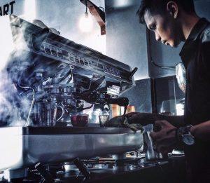 barista working at an espresso machine