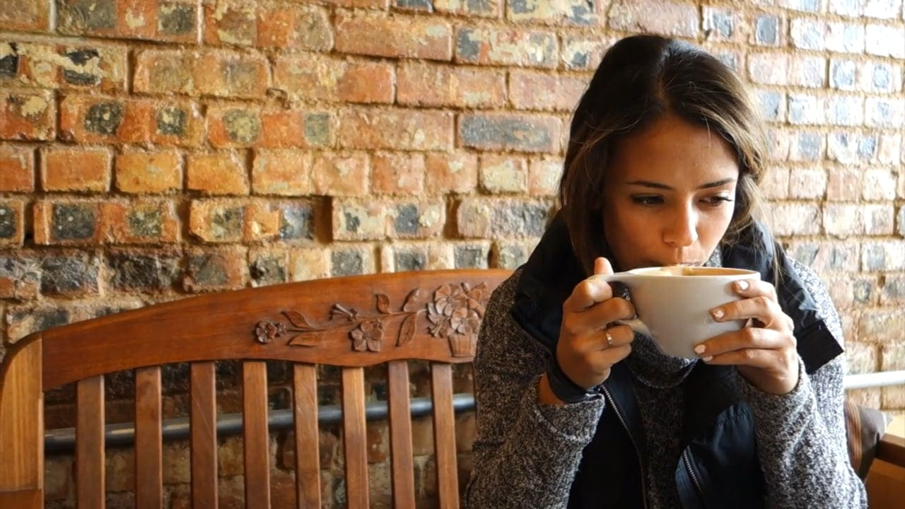 Woman drinking specialty coffee
