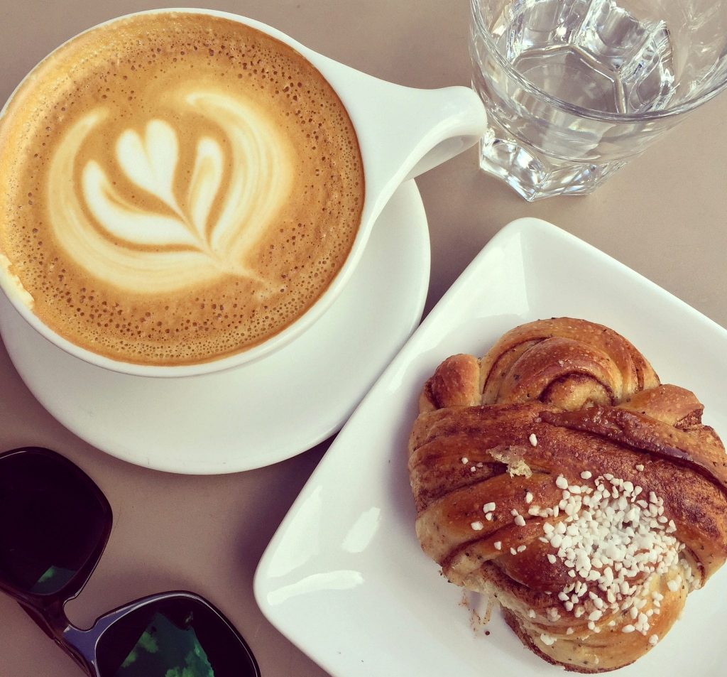 a cinnamon bun and coffee