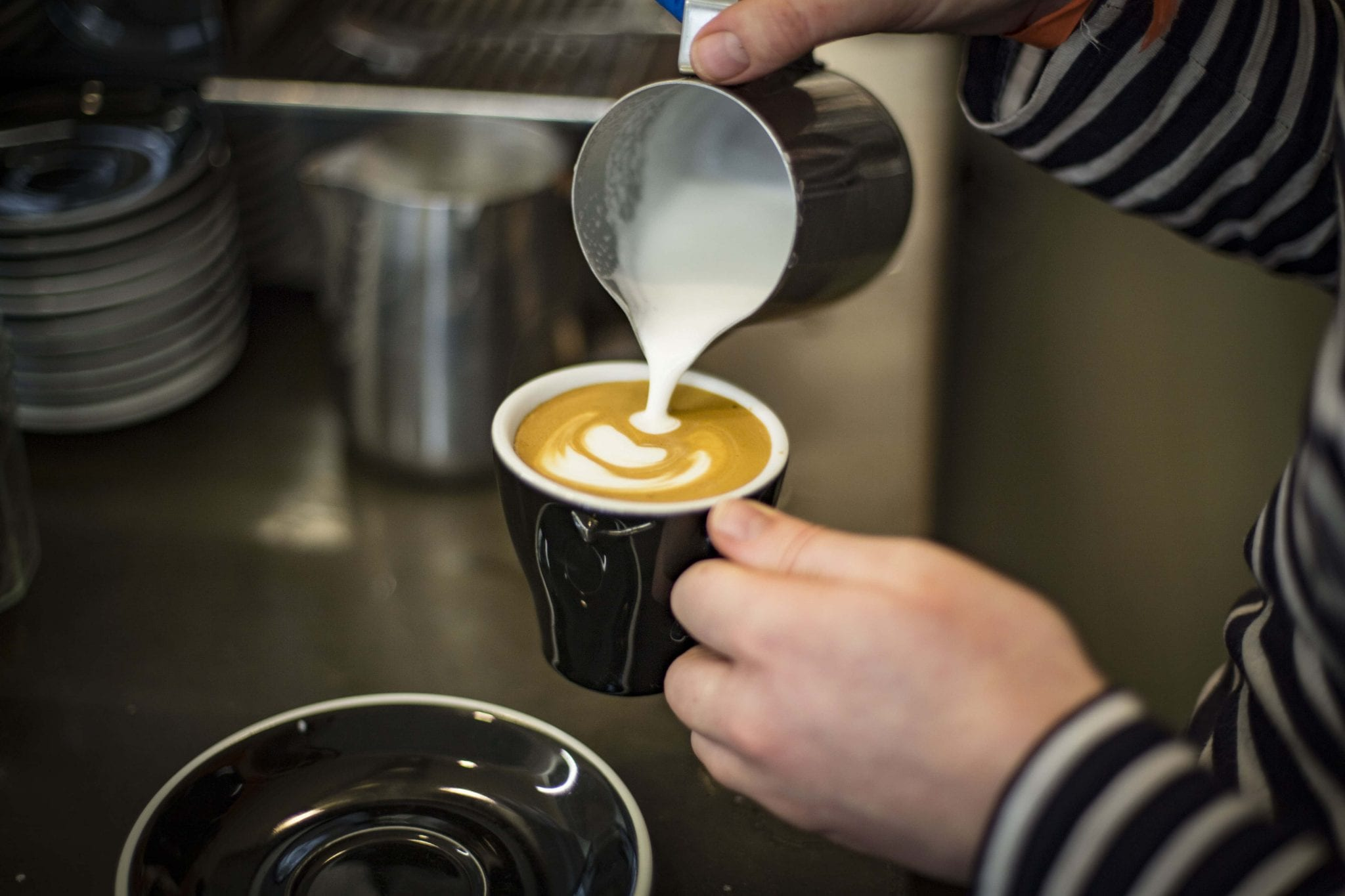 pouring a tulip latte art