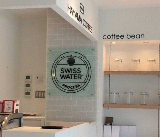 Inside Hayama Coffee, where the walls have Swiss Water's logo