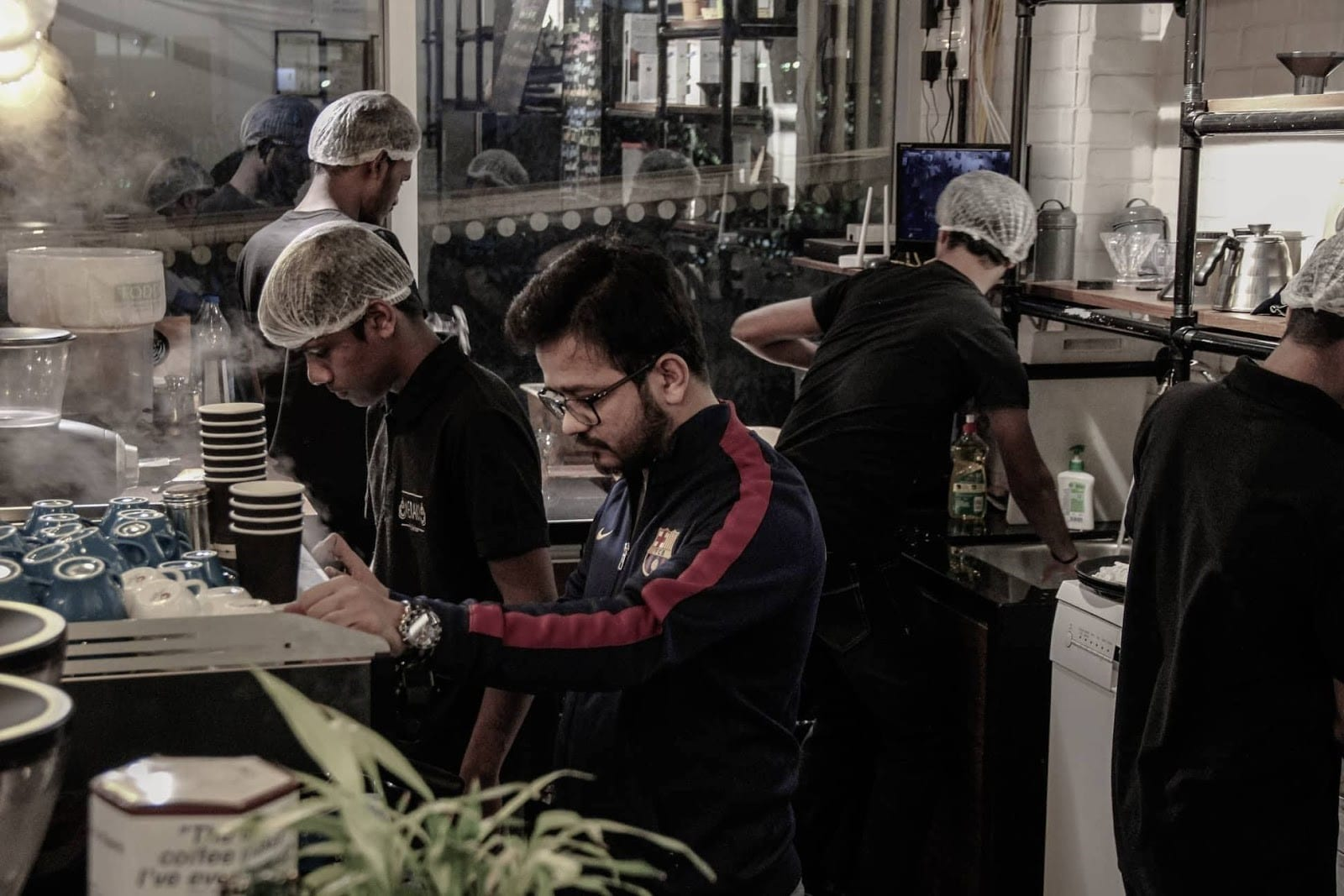 some baristas from india brew coffee for clients