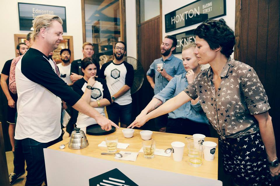 Jury pointing at the winning cup of coffee