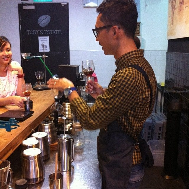 barista making coffee cocktails in a cafe