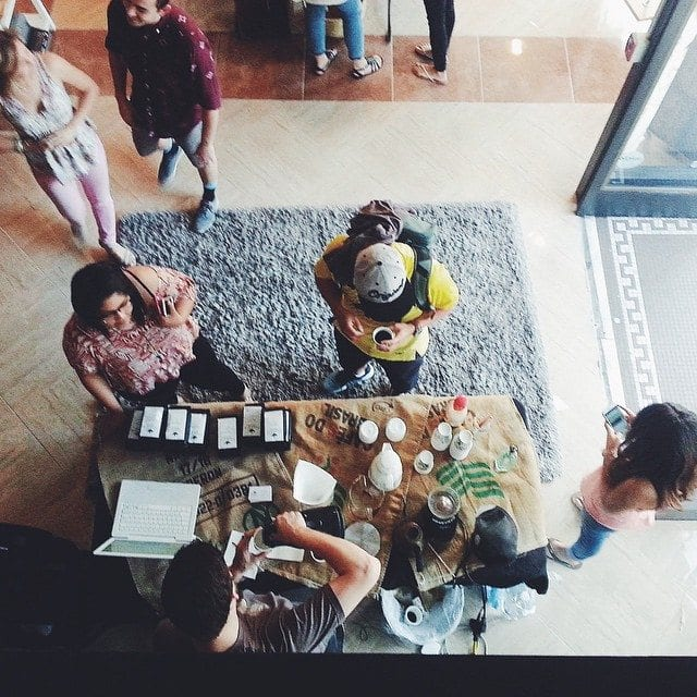 Coffee stand from above, surrounded by customers.
