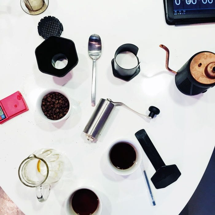 coffee brewing devices. pour over kettle, grinder, aeropress, scales, ipad.