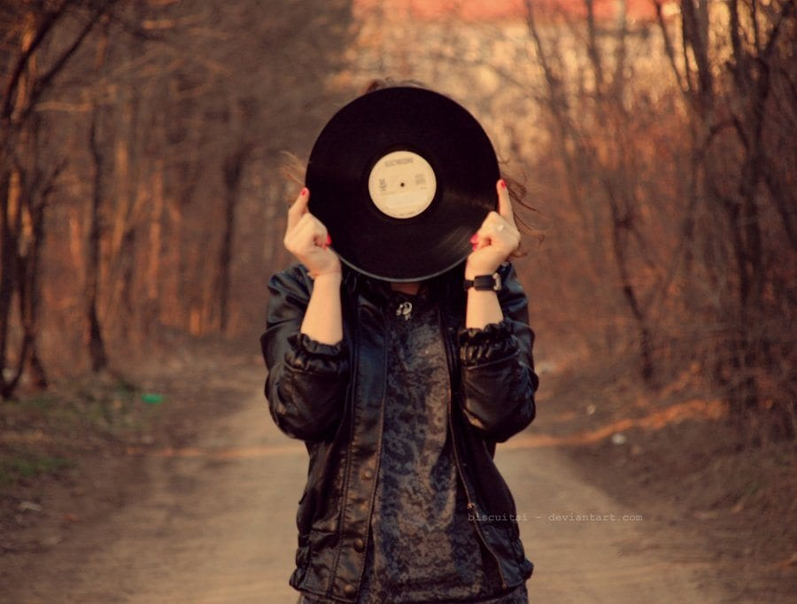 Girl holding vinyl in front of her face. Photo: BiscuiTsi