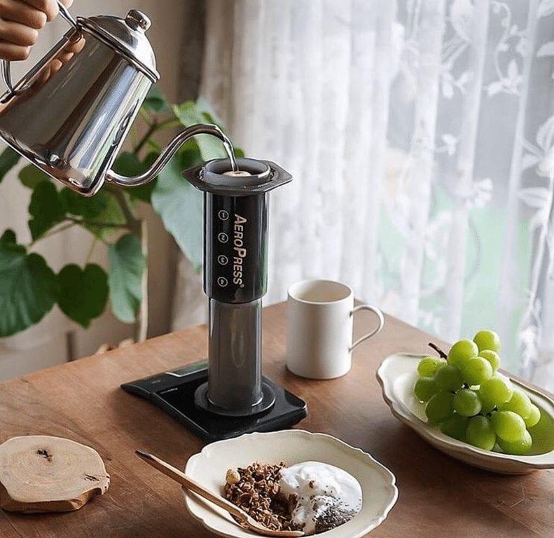 aeropress coffee brewing with breakfast