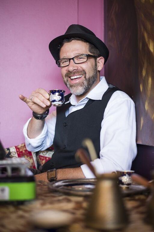 man drinking Turkish coffee