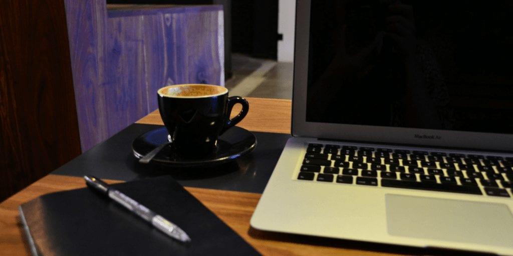 Coffee + laptop + notebook