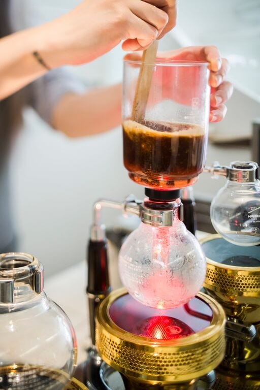 brewing coffee with a syphon