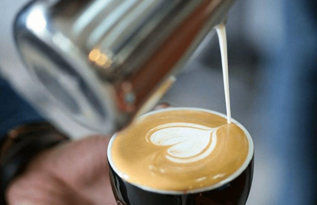 pouring a latte art heart