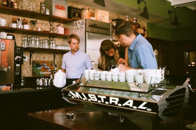 baristas behind the espresso machine