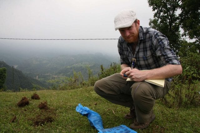 taking soil samples in preparation for the coffee planting