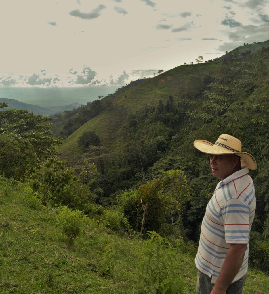 Joaquín, a small coffee farmer in Valle del Cauca, on his farm