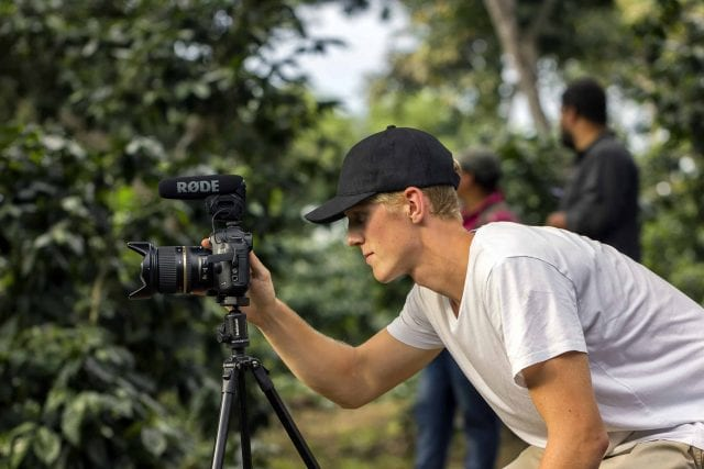 A. Kinnunen filming on a shade-grown coffee farm in Central America