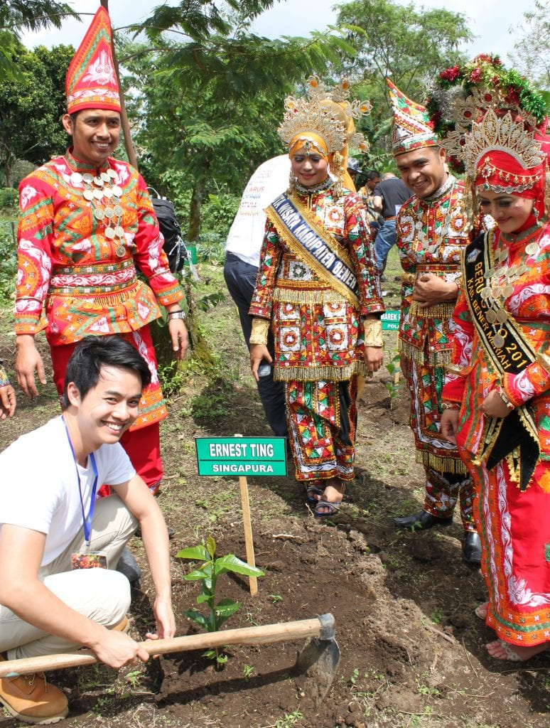 Javanese people in traditional dress on the coffee farm