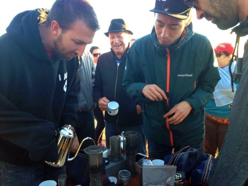 Tetsu Kasuya and Todd Goldsworthy making AeroPress coffee on the top of Pica de Bandeira