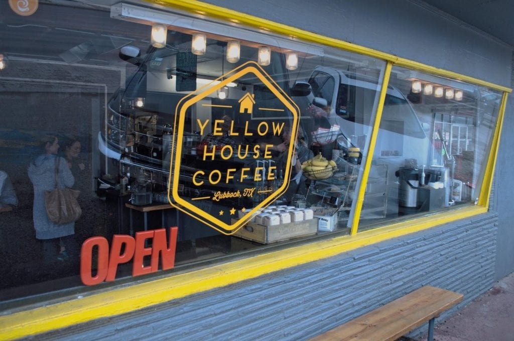 Yellow House Coffee window with logo on it