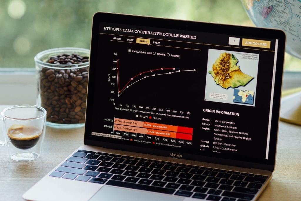 Laptop with Royal Coffee's roast analysis