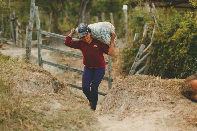 Carrying coffee sack