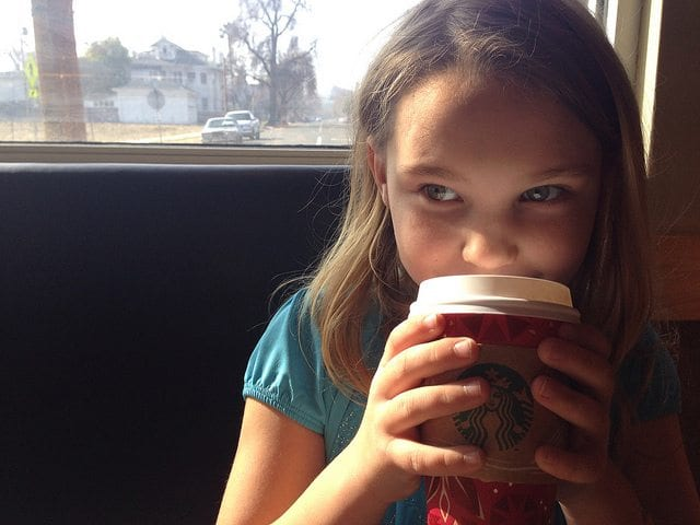 Young girl drinks Starbucks coffee