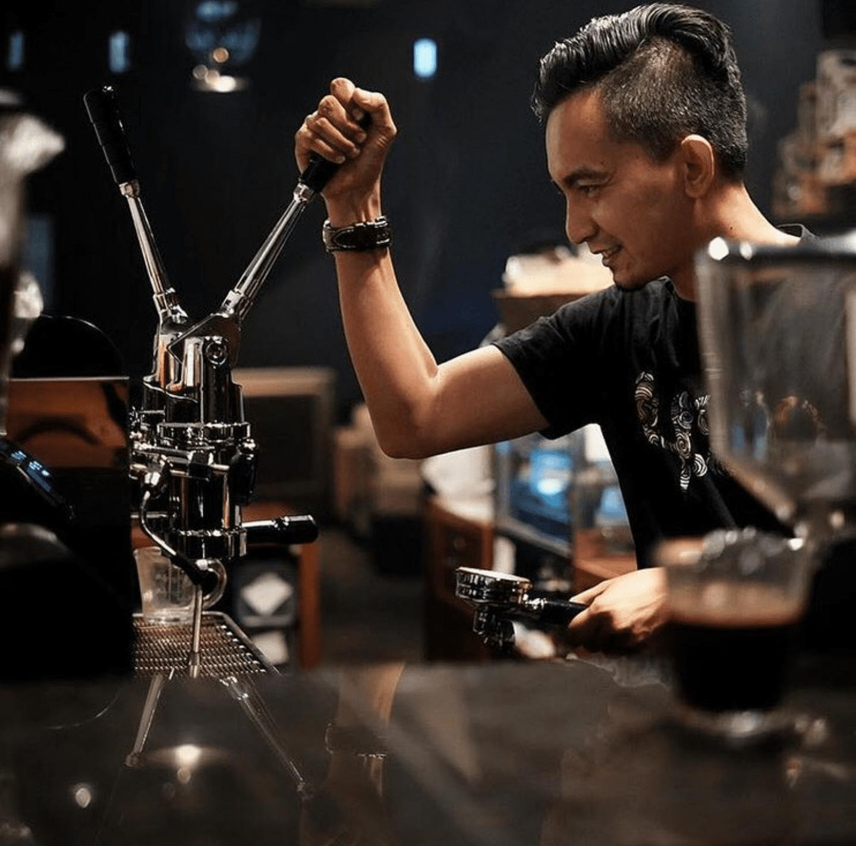 Barista making espressos