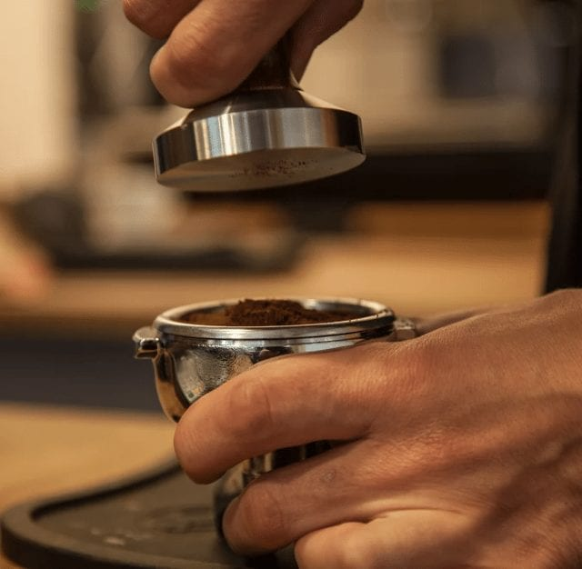 Barista tamping in order to make an espresso