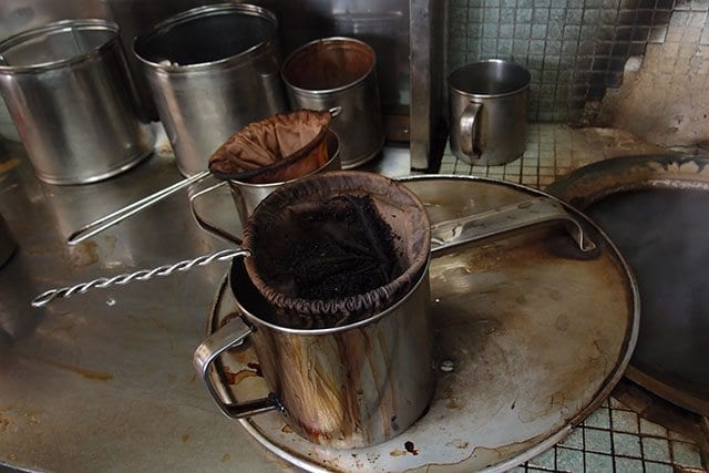 Brewed coffee grounds in filter