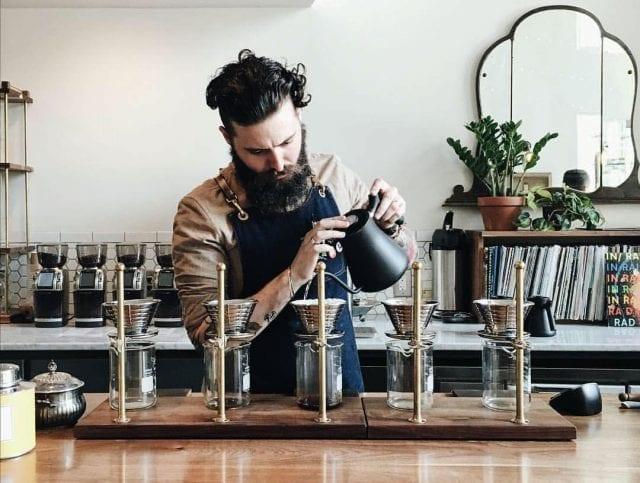 Barista brewing five different kalita