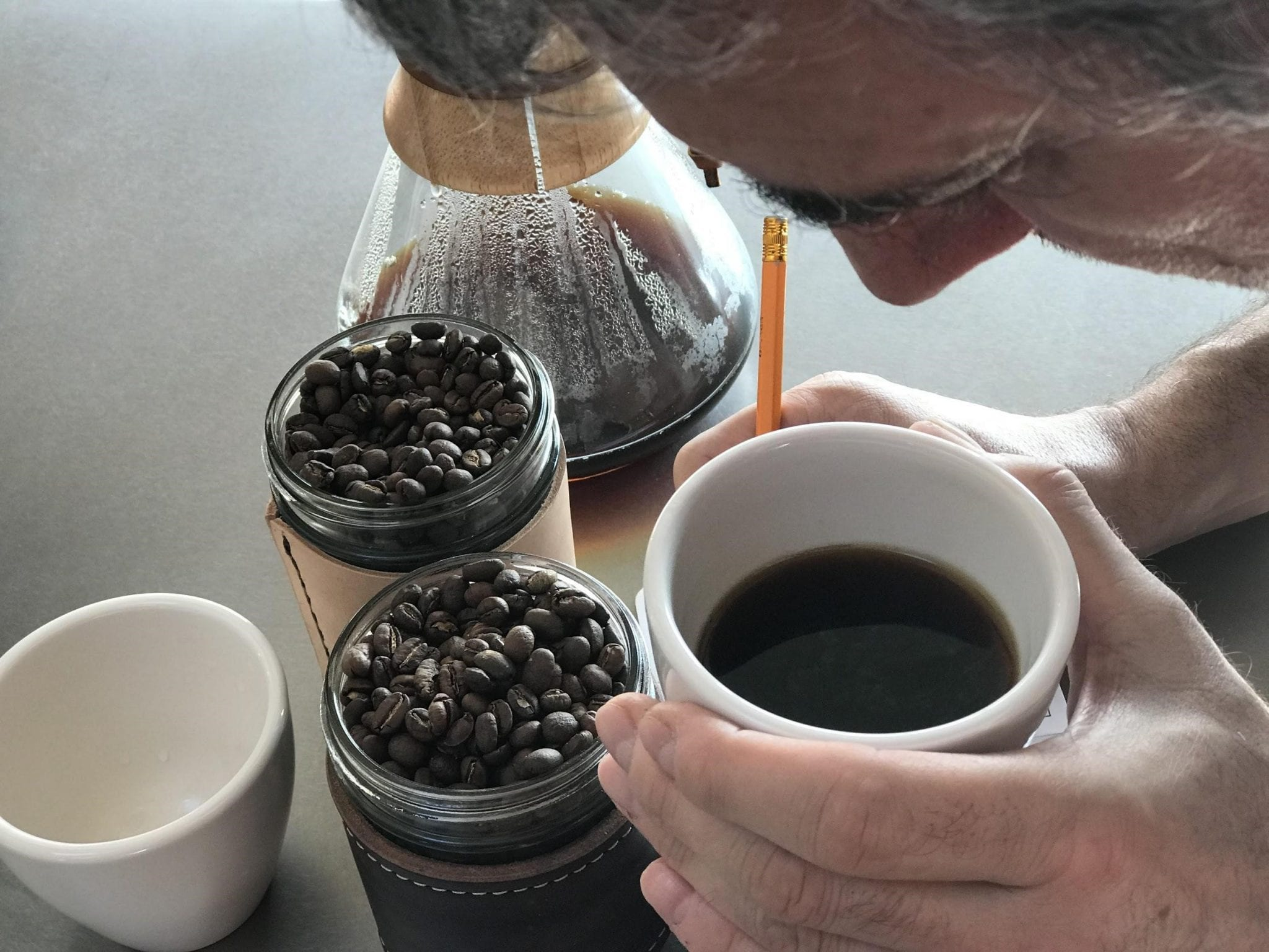 Roaster checking the aroma of a sample of roasted beans