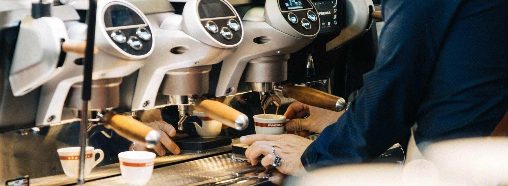 Barista making an espreeso with a Faema coffee machine