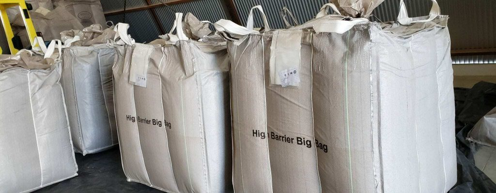 Big white high barrier bags with green coffee beans