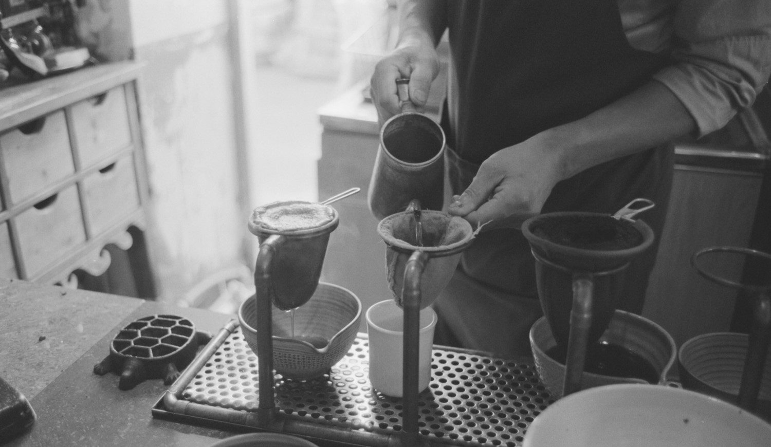 Barista brewing turkish coffee