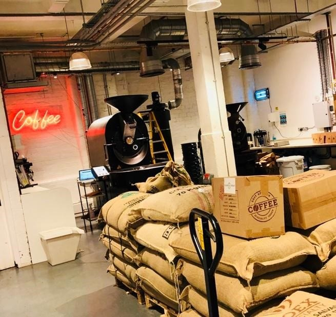 Internal view of Dear Green Coffee Roaster's showing bags of coffee.