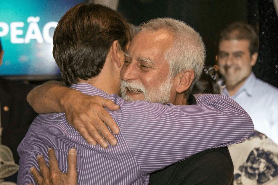 Renato Pita hugs people after winning Minasul Coffee Quality Contest