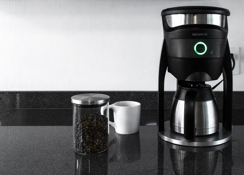Behmor Connected Brewer with mug and coffee beans