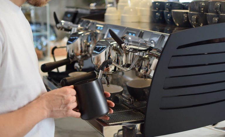 Barista steaming milk for a cappuccino