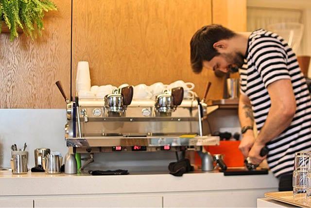 A barista makes coffee at Lowdown in Edinburgh.