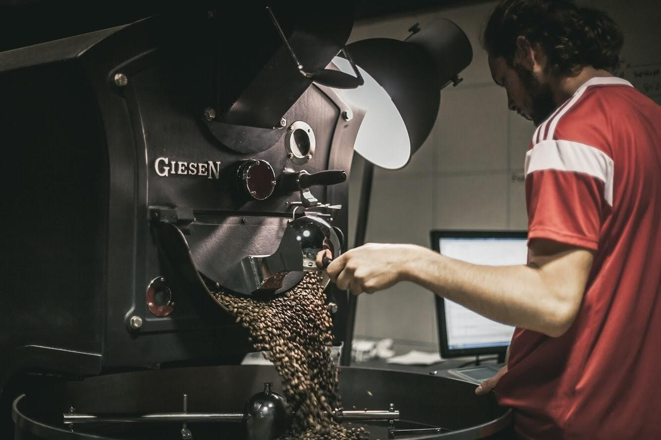 A roaster checking the coffee