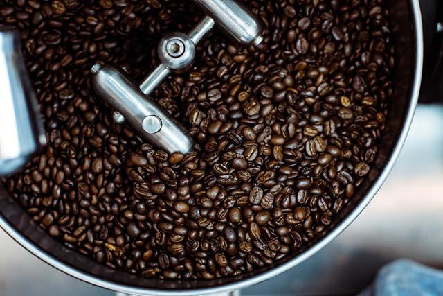 freshly roasted coffee in cooling pan