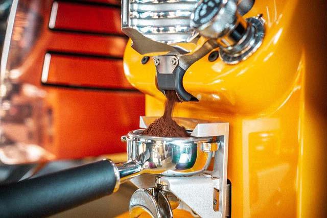 coffee grounds falling into espresso portafilter