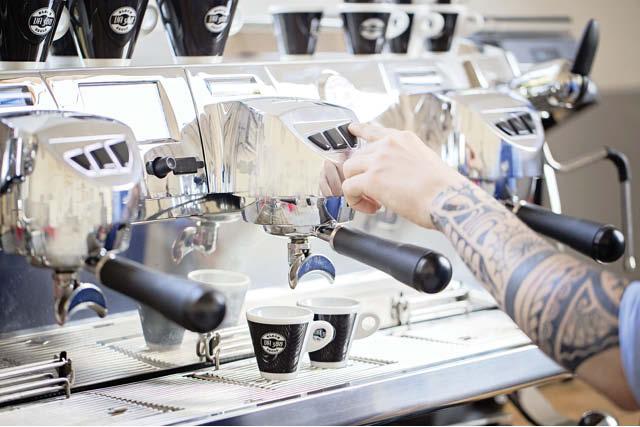 barista brewing shots of espresso