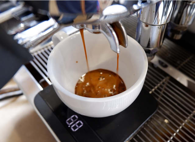 Espresso shot pouring into cup