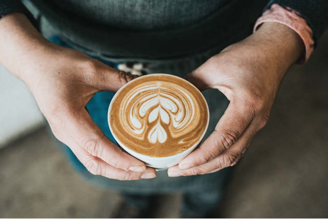 man holding a flat white
