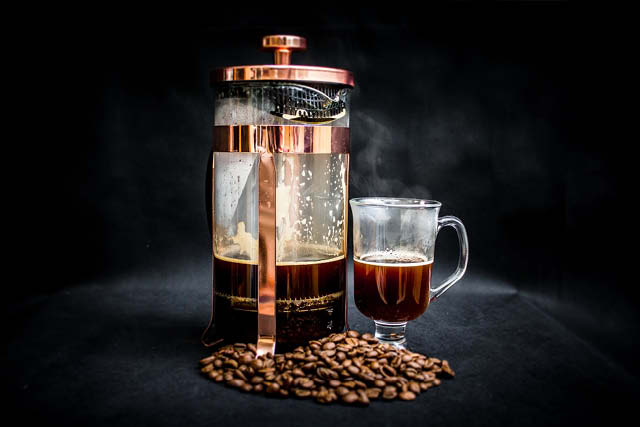 cup of coffee and copper french press
