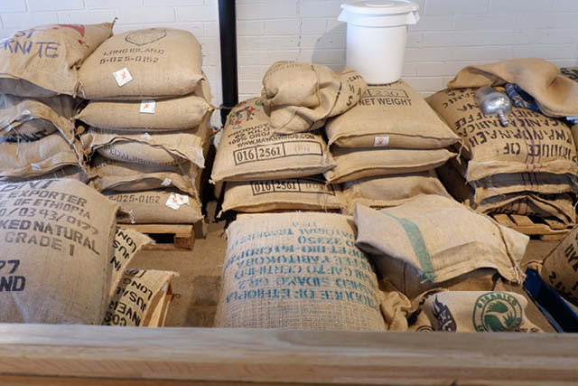 bags of coffee stacked in warehouse