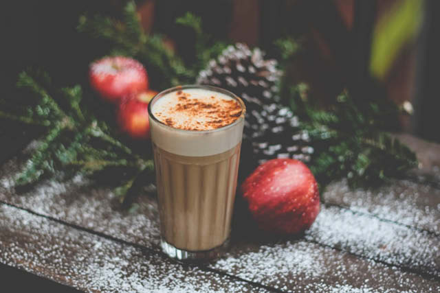 coffee drink next to christmas decorations