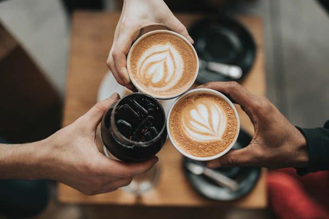 sharing coffee drinks