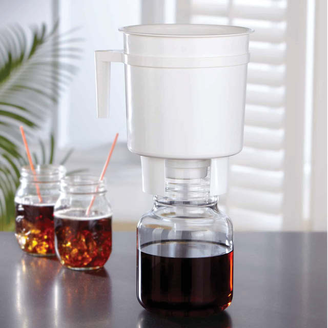 A Toddy brewing device and glasses of cold brew coffee